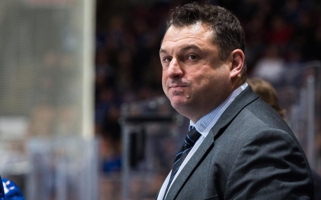 Smith hired by Senators as coach