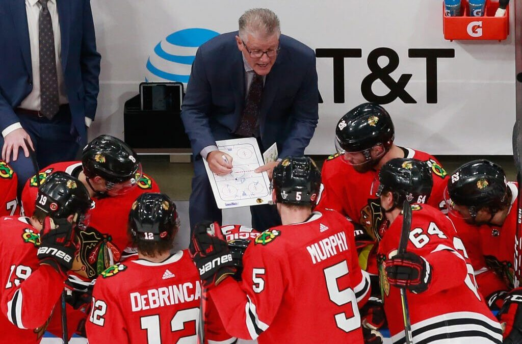 Father and son Marc and Dylan Crawford bring old- and new-school mentalities to Blackhawks coaching staff